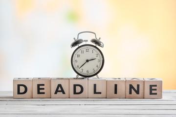 Clock on a deadline sign
