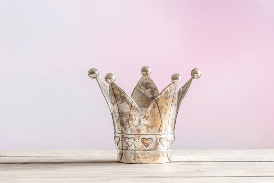 Royal crown on pink background