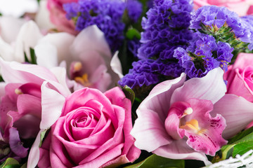 exotic bouquet with orchid and pink rose closeup