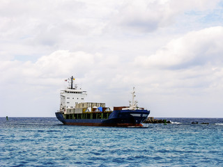 Cargo ship floats on water