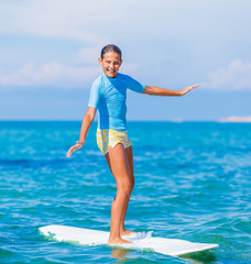 Young surfer girl