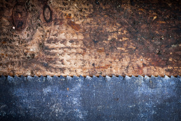 Hacksaw on wooden plank