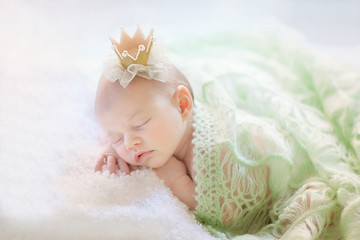 Newborn girl is sleeping like a princess.