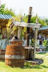 Old rusty wine press with oak barrel.