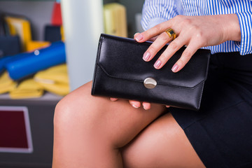 Business woman chooses wallet. Shop accessories.
