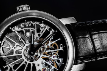 Elegant watch with visible mechanism, clockwork. Time, fashion, luxury concept.