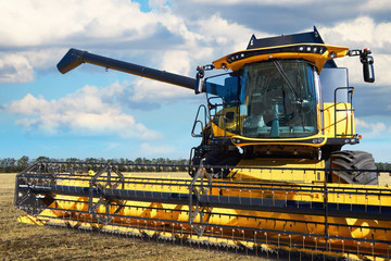 Wall Mural - Combine working in field