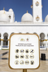 Signboard with the rules to follow at the Abu Dhabi Mosque