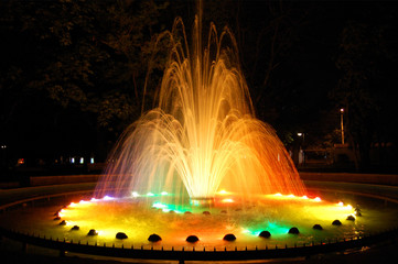 Magic fountain with colorful illuminations at night.