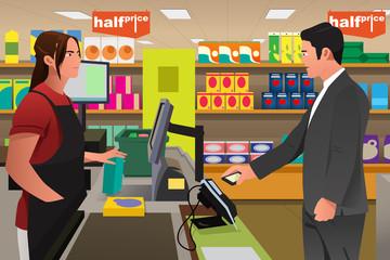Man Paying at the Cashier Using Phone