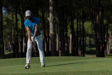 golf player hitting shot