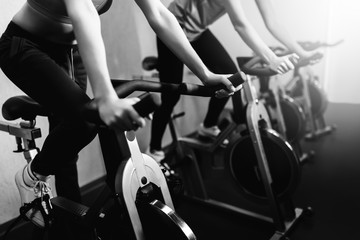Woman on fitness exercise bike at indoor