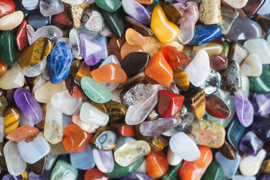 Background of polished colored gemstones
