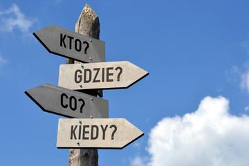 Kto? Gdzie? Co? Kiedy? Signpost in Polish.