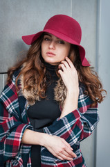 Fashion portrait stylish pretty woman outdoor. Street fashion. Red hat