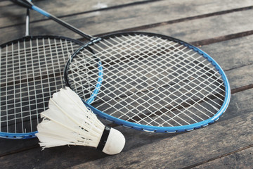 Shuttlecocks with badminton racket.