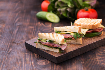 Sandwiches with bacon, cheese, greens and pea sprouts