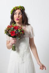 Worried bride holding bouquet