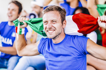 Supporters from Italy at stadium watching the match