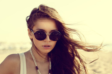 girl in sunglasses at beach