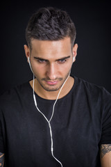 Young man with earphones listening to music