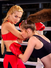 Two  women boxer wearing red  gloves to box in ring. Boxing martial arts.