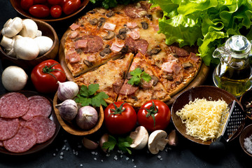 pizza with sausage and cheese and ingredients