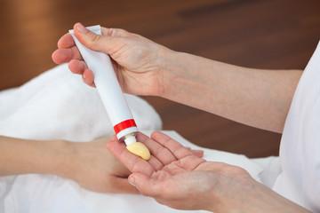 Hand treatment, therapist applying hand cream