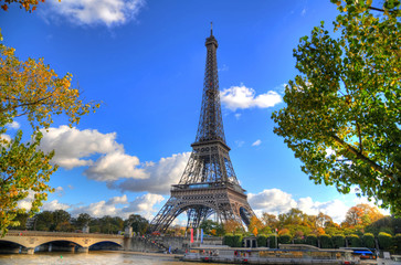 Colorful HDR image of the Eiffel Tower over the Seine on a spring day in Paris, France
