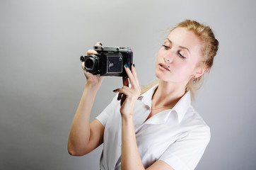 beautiful girl with a retro camera