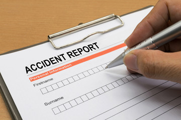 man signing a accident report form