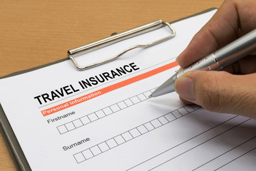 man signing a travel insurance policy