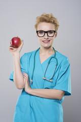 Female dentist holding an apple