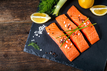 Salmon filet sliced on three parts with lime and herbs.