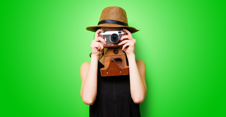 portrait of the young woman with camera