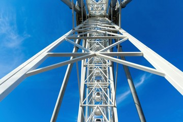 abstract design of a ferris wheel against the sky