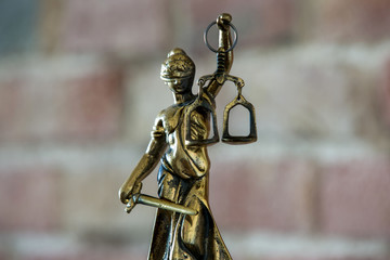 Lady Justice - Temida - Themis, Lady of Justice on background of the wall
