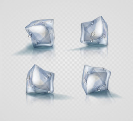 Set of four transparent ice cubes in light blue colors with drops
