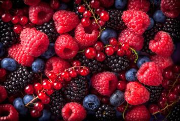 Berries mix in studio dark background