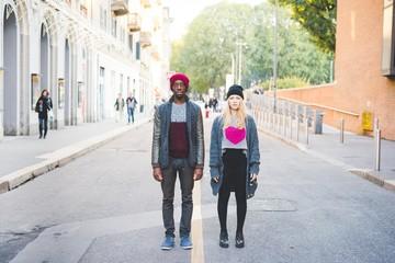 Couple standing on street