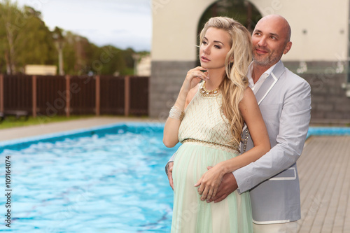 The Husband Goes Out With His Pregnant Wife At The Pool Stock Photo And Royalty Free Images On