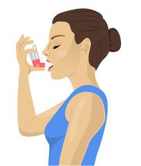 Pretty brunette using an asthma inhaler on white bakcground