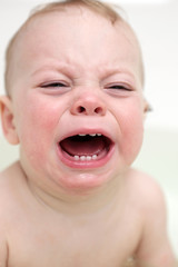 Crying toddler in bathroom