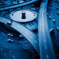 aerial view of traffic on chongqing caiyuanba overpass,blue toned image.