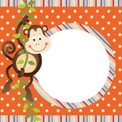 Monkey hanging in tree frame background