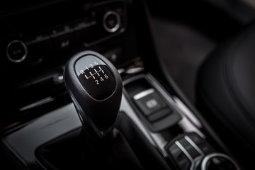 Gearshift handle in modern car black interior