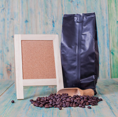 package of coffee beans and menu board on the wooden