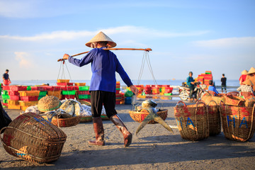 LONG HAI, VIET NAM - MAY 31 2015: Unidentified People working at