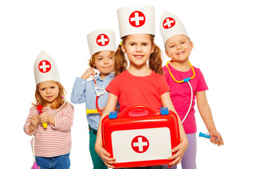 Kids with medical box and toy doctor instruments