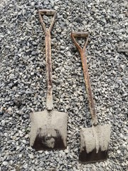 shovel and stone for mix cement in construction place